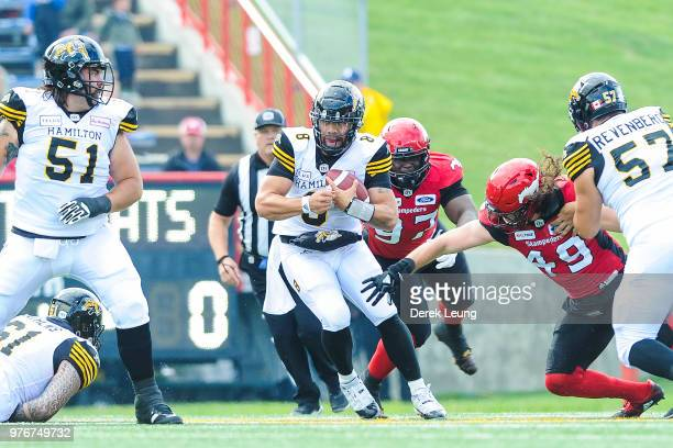 Jeremiah Masoli of the Hamilton Tiger-Cats carries the ball against the Calgary Stampeders during a CFL game at McMahon Stadium on June 16, 2018 in...