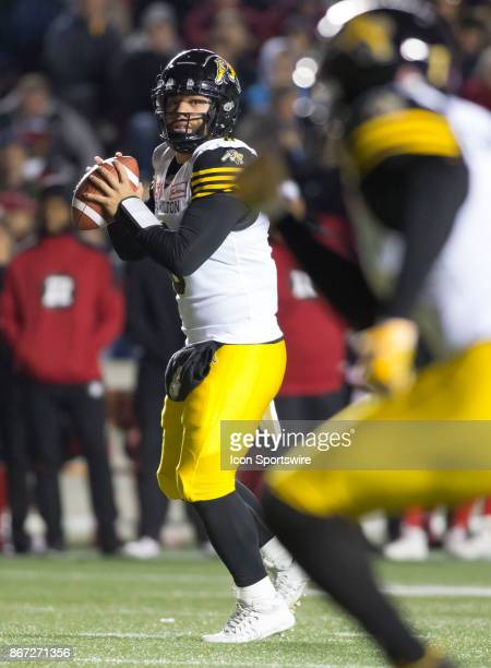 Jeremiah Masoli of the Hamilton TigerCats looks for a receiver against the Ottawa Redblacks in Canadian Football League play at TD Place Stadium in...
