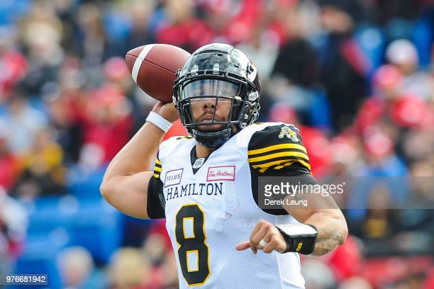 Jeremiah Masoli of the Hamilton TigerCats makes a pass against the Calgary Stampeders during a CFL game at McMahon Stadium on June 16 2018 in Calgary...