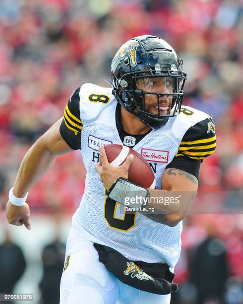 Jeremiah Masoli of the Hamilton Tiger-Cats makes a pass against the Calgary Stampeders during a CFL game at McMahon Stadium on June 16, 2018 in...