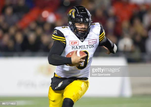 Jeremiah Masoli of the Hamilton TigerCats runs upfield with the ball against the Ottawa Redblacks in Canadian Football League play at TD Place...