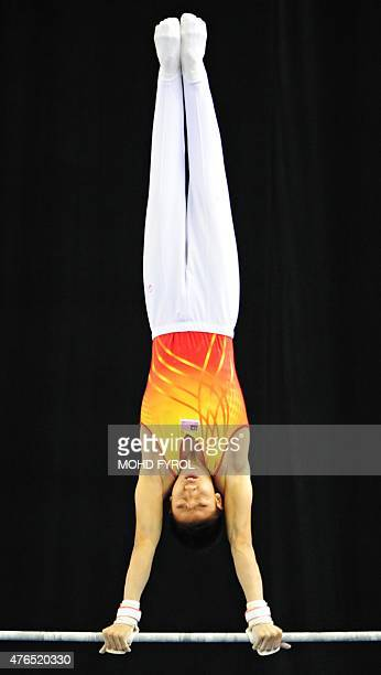 Jeremiah Phay Xing Loo of Malaysia competes during the men's parallel bars final at the 28th Southeast Asian Games in Singapore on June 10 2015 AFP...