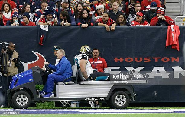 Jeremiah Poutasi of the Jacksonville Jaguars is carted off the field with an ankle injury against the Houston Texans at NRG Stadium on December 18...