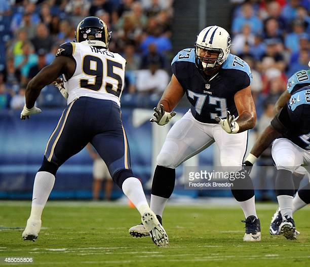 Jeremiah Poutasi of the Tennessee Titans blocks William Hayes of the St Louis Rams during the first half of a preseason game at LP Field on August 23...