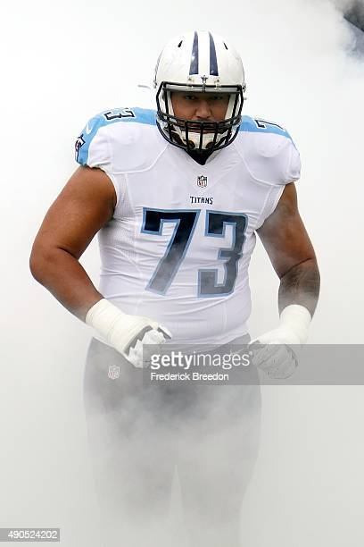 Jeremiah Poutasi of the Tennessee Titans runs onto the field prior to a game against the Indianapolis Colts at Nissan Stadium on September 27 2015 in...