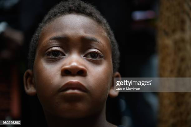 Jeremiah Rooke of the North Side listens during a rally by more than 200 people protesting the fatal shooting of an unarmed black teen at the...
