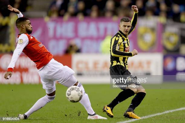 Jeremiah St Juste of Feyenoord Bryan Linssen of Vitesse during the Dutch Eredivisie match between Vitesse v Feyenoord at the GelreDome on February 11...