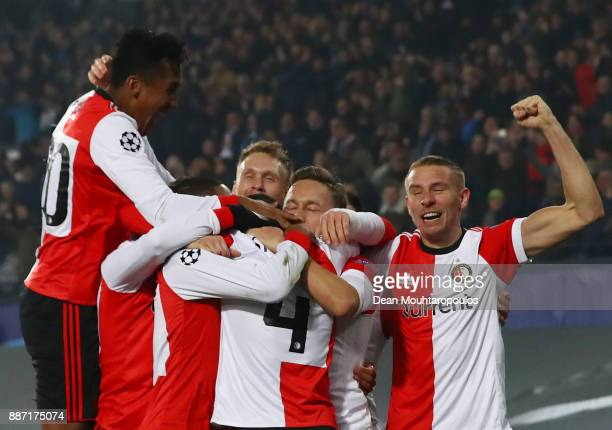 Jeremiah St Juste of Feyenoord celebrates after scoring his sides second goal with his Feyenoord team mates during the UEFA Champions League group F...