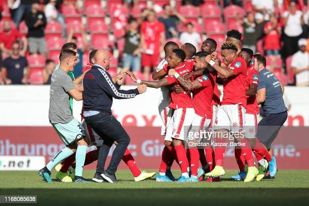 Jeremiah St.Juste of 1.FSV Mainz 05 celebrates after scoring his team's second goal with Managing director Sport Rouven Schroeder of 1.FSV Mainz 05...