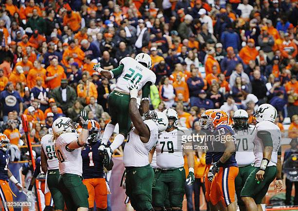 Jeremiah Warren of the South Florida Bulls lifts up teammate Marcus Shaw after a touchdown against the Syracuse Orange during the game at the Carrier...