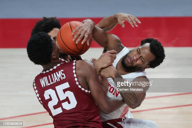 Jeremiah Williams of the Temple Owls collides with Justin Gorham of the Houston Cougars during the first half of a game at Fertitta Center on...