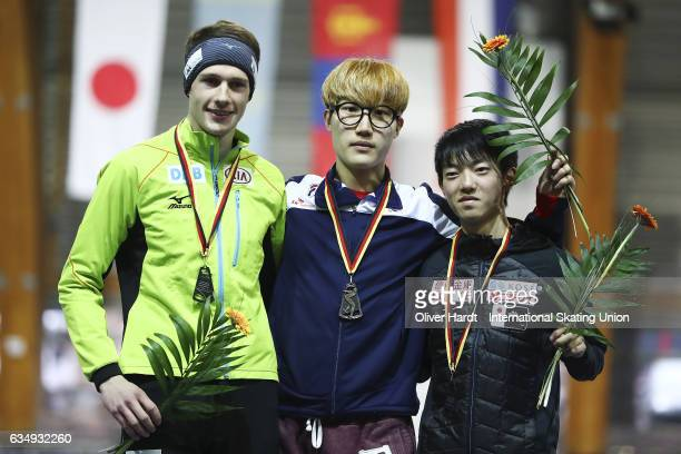Jeremias Marx of Germany with the second place Hyun Min Oh of Korea with the first place and Kohki Takamisawa of Japan with the third place celebrate...