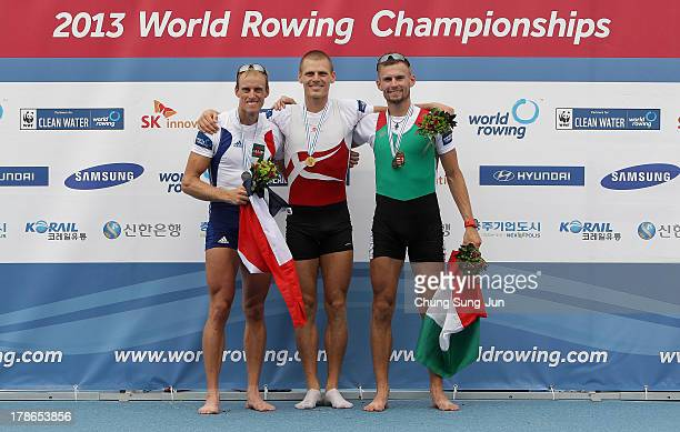 Jeremie Azou of France Henrik Stephansen of Denmark and Peter Galambos pose with their medals after the Lightweight Men's Single Sculls final during...