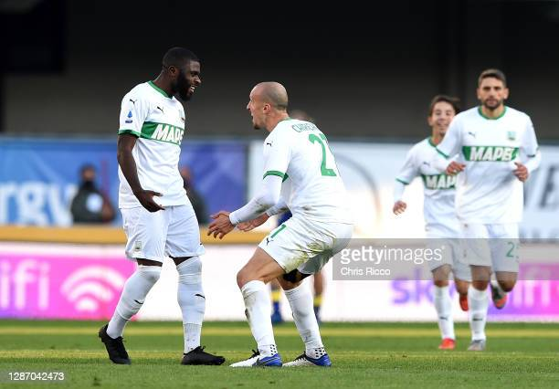 Jeremie Boga of US Sassuolo celebrates after scoring their sides first goal with Vlad Chiriches of US Sassuolo during the Serie A match between...