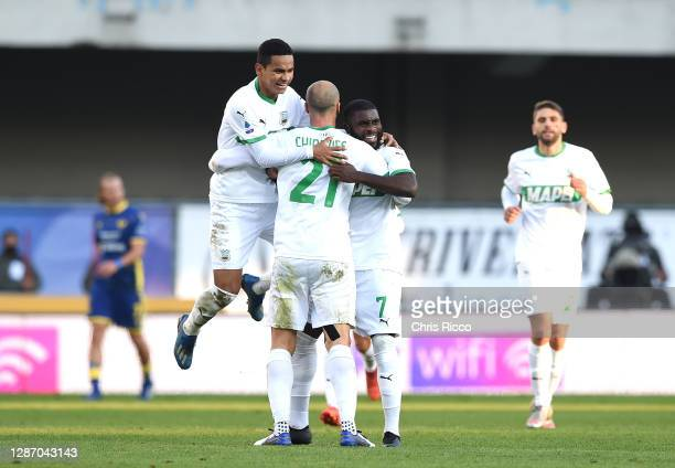Jeremie Boga of US Sassuolo celebrates after scoring their sides first goal with Rogerio of US Sassuolo and Vlad Chiriches of US Sassuolo during the...