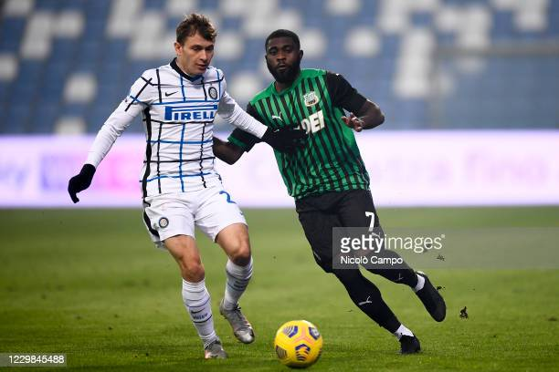 Jeremie Boga of US Sassuolo competes for the ball with Nicolo Barella of FC Internazionale during the Serie A football match between US Sassuolo and...