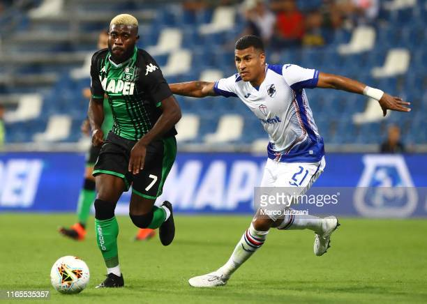 Jeremie Boga of US Sassuolo is challenged by Jeison Murillo of UC Sampdoria during the Serie A match between US Sassuolo and UC Sampdoria at Mapei...