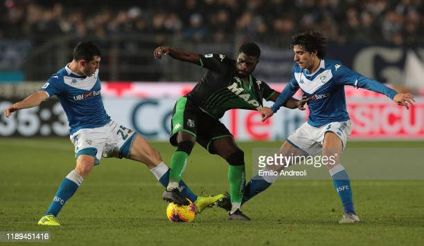 Jeremie Boga of US Sassuolo is challenged by Sandro Tonali and Dimitri Bisoli of Brescia Calcio during the Serie A match between Brescia Calcio and...