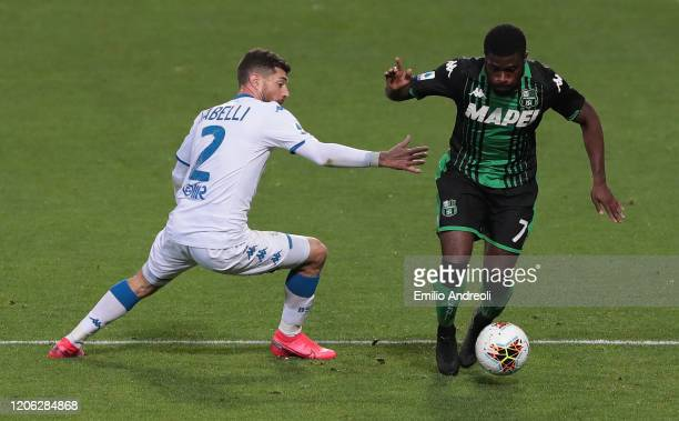 Jeremie Boga of US Sassuolo is challenged by Stefano Sabelli of Brescia Calcio during the Serie A match between US Sassuolo and Brescia Calcio at...