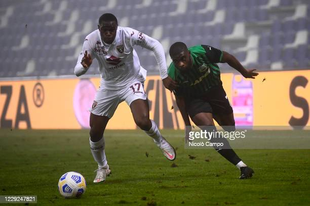 Jeremie Boga of US Sassuolo is challenged by Wilfried Singo of Torino FC during the Serie A football match between US Sassuolo and Torino FC The...