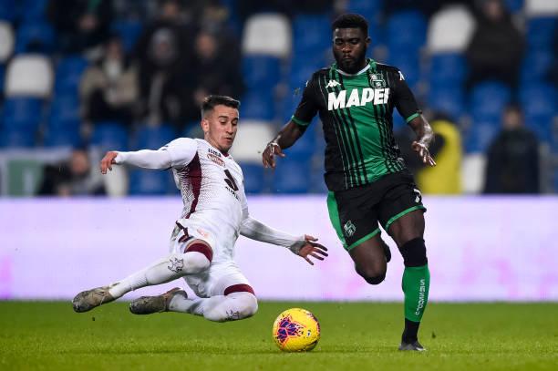 Jeremie Boga (R) of US Sassuolo is tackled by Alejandro '...