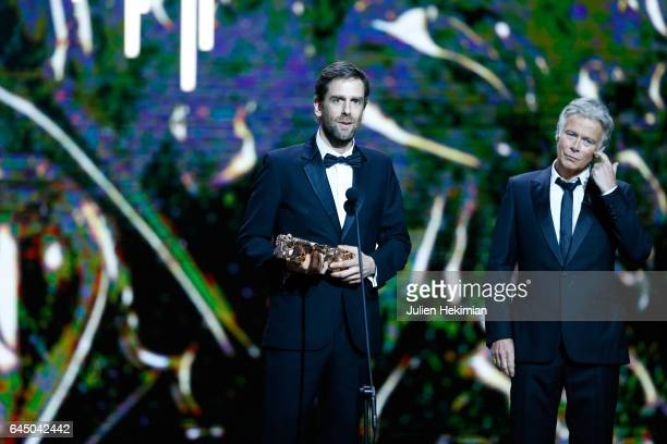 Jeremie DLignol receives the Cesar of Best Production Design for 'Chocolat' on stage during the Cesar Film Awards Ceremony at Salle Pleyel on...