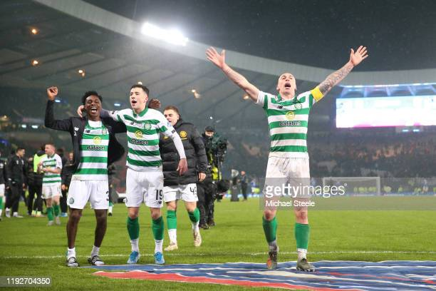 Jeremie Frimpong, Michael Johnstone and Scott Brown of Celtic celebrate victory following the Betfred Cup Final between Rangers FC and Celtic FC at...