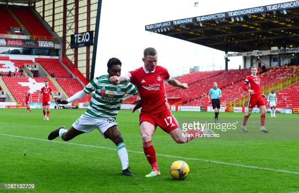 Jeremie Frimpong of Celtic and Jonathan Hayes of Aberdeen battle for the ball during the Ladbrokes Scottish Premiership match between Aberdeen and...