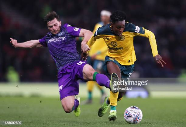 Jeremie Frimpong of Celtic FC is challenged by Lewis Stevenson of Hibernian FC during the Betfred Cup SemiFinal match between Hibernan and Celtic at...