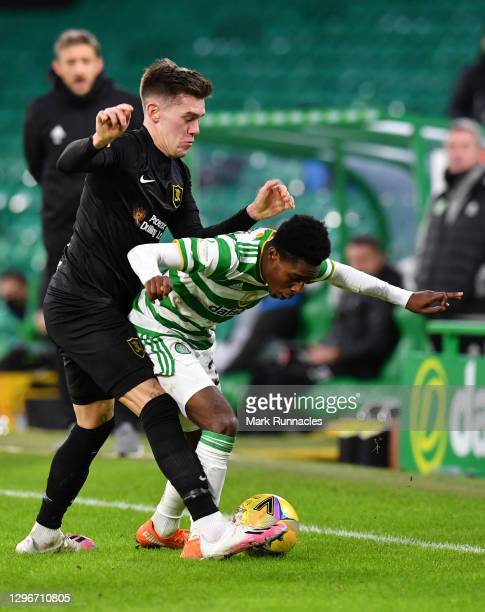 Jeremie Frimpong of Celtic is challenged by Josh Mullin of Livingston FC during the Ladbrokes Scottish Premiership match between Celtic and...