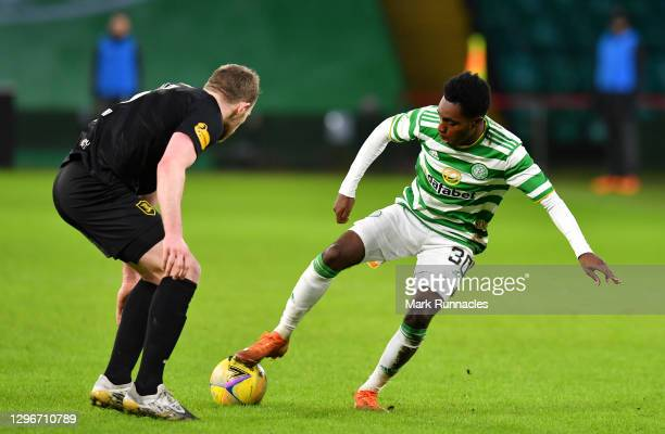 Jeremie Frimpong of Celtic is challenged by Nicky Devlin of Livingston FC during the Ladbrokes Scottish Premiership match between Celtic and...