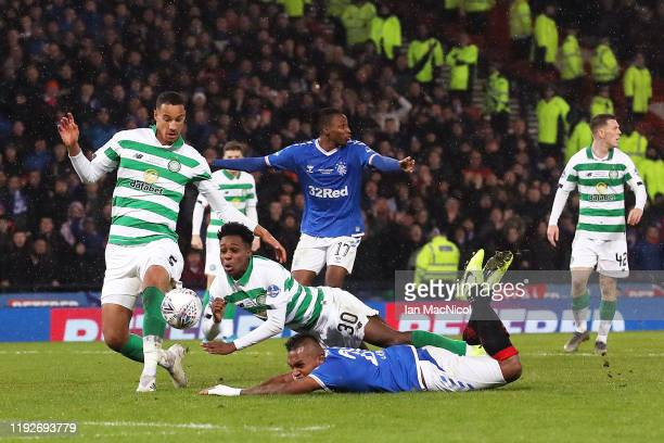 Jeremie Frimpong of Celtic tackles Alfredo Morelos of Rangers FC which leads to a penalty and a red card for Jeremie Frimpong of Celtic during the...