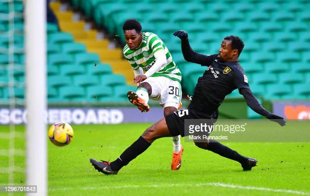 Jeremie Frimpong of Celtic takes a shotunder pressure from Efe Ambrose of Livingston FC during the Ladbrokes Scottish Premiership match between...