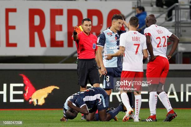 Jeremie Pignard referee gives a red card to Ernest Seka of Nancy during the French Ligue 2 match between Nancy and Le Havre on September 14 2018 in...