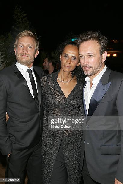 Jeremie Renier, Karine Silla and Vincent Perez attend the Dior & ELLE Magazine Dinner at the 67th Annual Cannes Film Festival at Albane by Costes, JW...