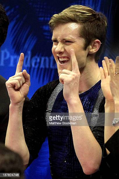 Jeremy Abbott celebrates in the Kiss and Cry as he views his score after competing in the Senior Men's Short Program during the 2012 Prudential US...
