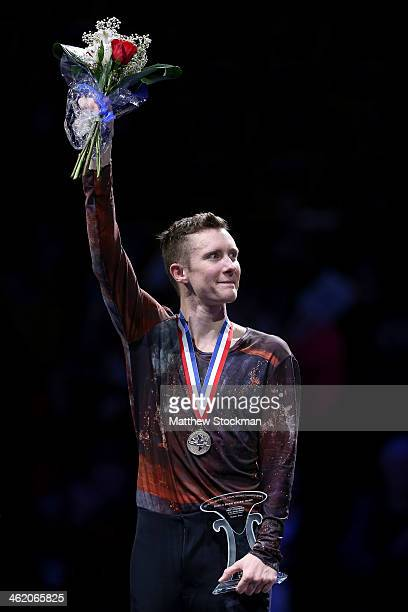 Jeremy Abbott celebrates on the medals podium after winning the men's competition during the Prudential US Figure Skating Championships at TD Garden...