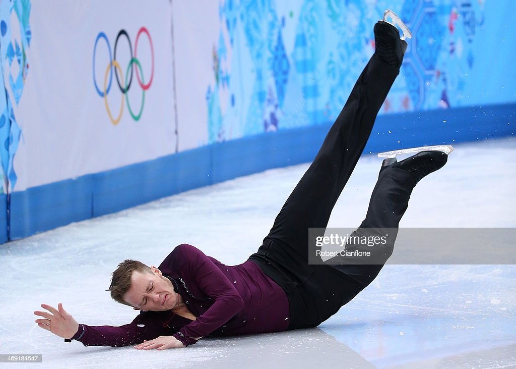 Jeremy Abbott of the United States falls while competing during the Men's Figure Skating Short Program on day 6 of the Sochi 2014 Winter Olympics at the at Iceberg Skating Palace on February 13, 2014 in Sochi, Russia.