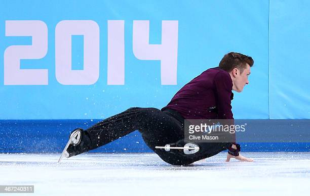 Jeremy Abbott of the United States falls while competing in the Figure Skating Men's Short Program during the Sochi 2014 Winter Olympics at Iceberg...