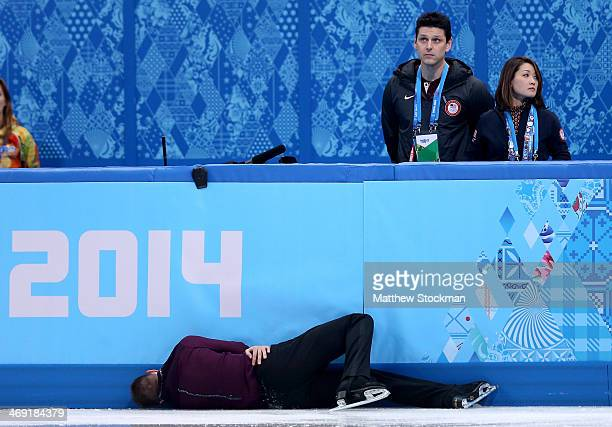 Jeremy Abbott of the United States hits the wall in front of his coaches Yuka Sato and Jason Dungjen while competing during the Men's Figure Skating...
