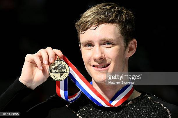 Jeremy Abbott poses for photographers after winning the Men's competition during the 2012 Prudential US Figure Skating Championships at the HP...