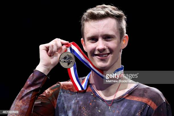 Jeremy Abbott poses for photographers on the medals podium after winning the men's competition during the Prudential US Figure Skating Championships...