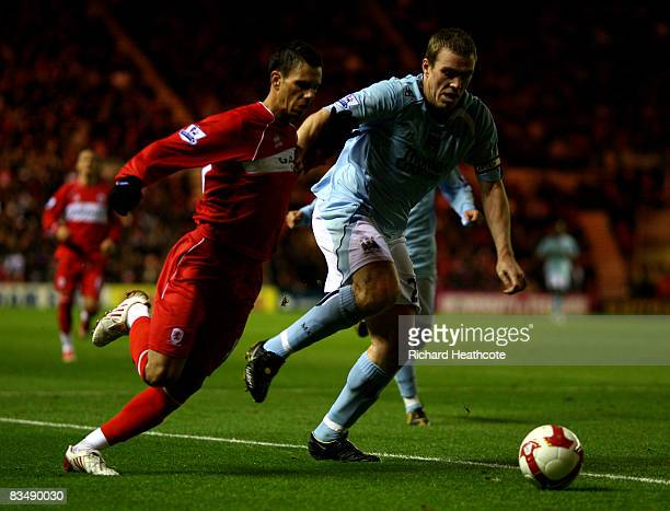Jeremy Aliadiere of Boro goes past Richard Dunne of Man City during the Barclays Premier League match between Middlesbrough and Manchester City at...