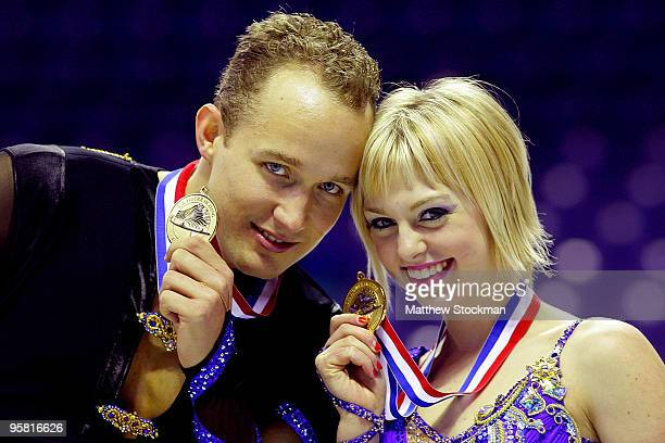 Jeremy Barrett and Caydee Denney pose for photographers after the pairs free skate during the US Figure Skating Championships at Spokane Arena on...