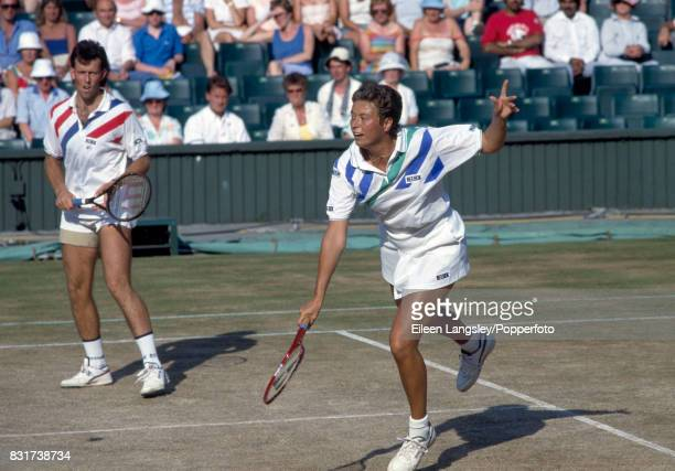 Jeremy Bates and Jo Durie of Great Britain enroute to their victory in the mixed doubles final at the Wimbledon Lawn Tennis Championships in London...