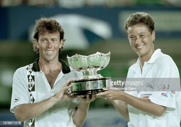 Jeremy Bates and Jo Durie of Great Britain lift their trophy after winning the Mixed Doubles Final of the 1991 Australian Open at Melbourne Park on...