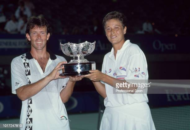 Jeremy Bates and Jo Durie of Great Britain pose with the trophy after defeating Robin White and Scott Davis both of the USA in the Mixed Doubles...