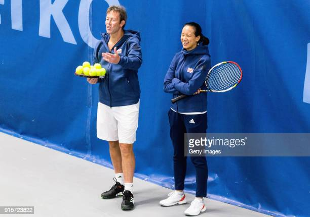 Jeremy Bates Great Britain coach and Anne Keothavong Great Britain head coach watch the players train during the Great Britain Training session ahead...