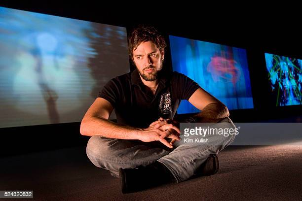 Jeremy Blake a digital artist poses near his newest 3screen installation at SF Museum of Modern Art based on the Winchester Mystery House located in...