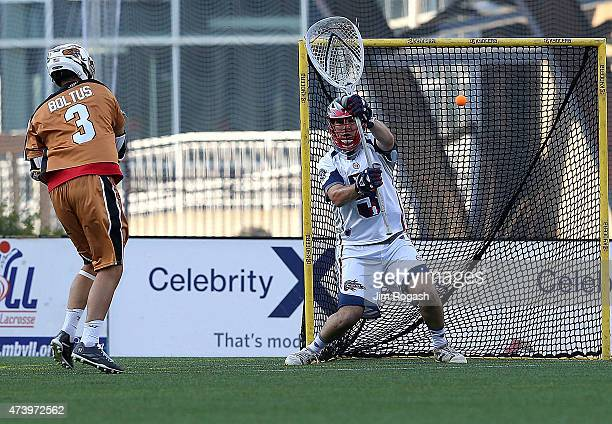 Jeremy Boltus of the Rochester Rattlers shoots on Jordan Burke of the Boston Cannons at Gillette Stadium on May 17 2015 in Foxboro Massachusetts